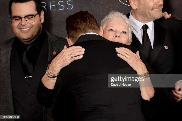 Johnny Depp and Dame Judi Dench attend the 'Murder On The Orient Express' World Premiere at Royal Albert Hall on November 2 2017 in London England