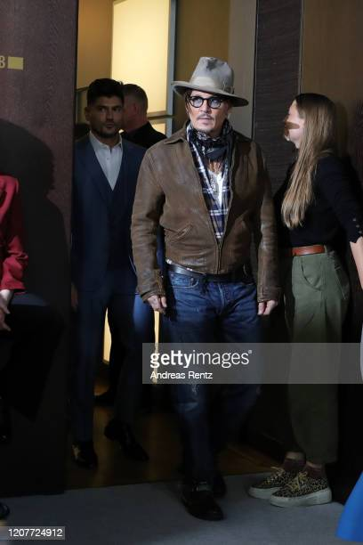 Johnny Depp and director Andrew Levitas arrive for the Minamata photo call during the 70th Berlinale International Film Festival Berlin at Grand...