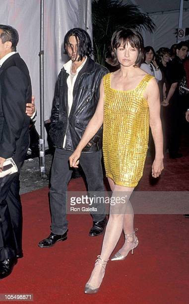 Johnny Depp and Ellen Barkin during APLA Fashion Show Honors Isaac Mizrahi May 4 1994 at Mann's Chinese Theater in Hollywood New York United States