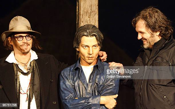 Johnny Depp and Emir Kusturica unveil a statue of Johnny Depp during the Kustendorf film festival on January 13, 2010 in Belgrade, Serbia.