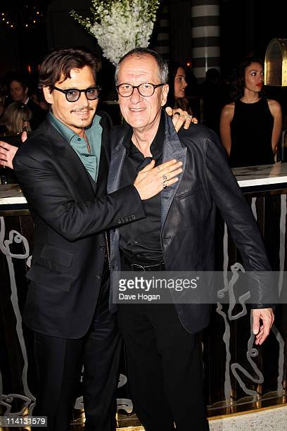 Johnny Depp and Geoffrey Rush attend the UK premiere afterparty of 'Pirates Of The Caribbean On Stranger Tides' at Massimo Restaurant and Oyster Bar...