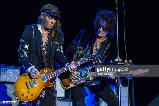 Johnny Depp and Joe Perry of Hollywood Vampires perform live on stage at Wembley Arena on June 20 2018 in London England