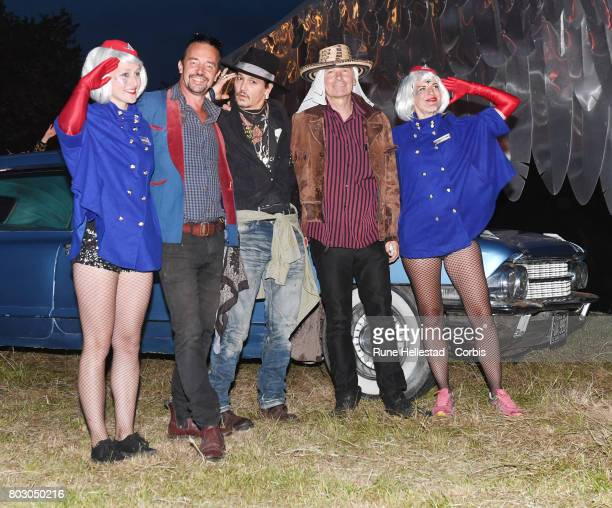 Johnny Depp and Julien Temple attend day 1 of the Glastonbury Festival 2017 at Worthy Farm Pilton on June 22 2017 in Glastonbury England