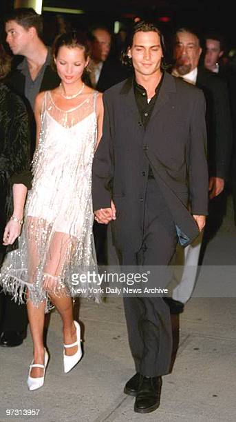 Johnny Depp and Kate Moss attending opening of Depp's movie 'Ed Wood'
