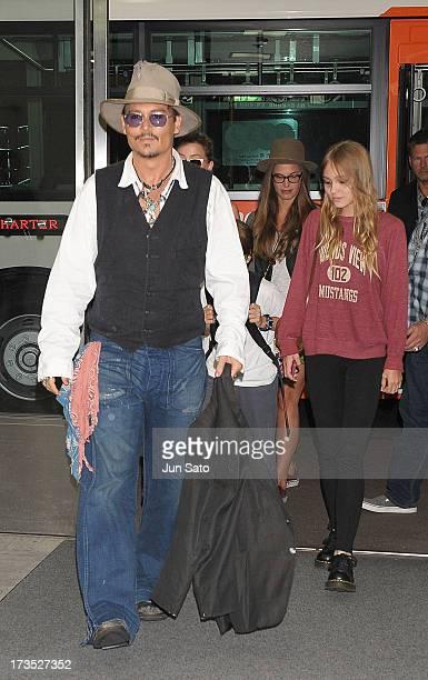Johnny Depp and Lily Rose Melody Depp arrive at Narita International Airport on July 16 2013 in Narita Japan