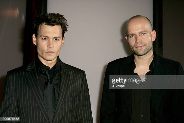 Johnny Depp and Marc Forster director during 2004 Venice Film Festival 'Finding Neverland' Premiere at Palazzo Del Cinema in Venice Lido Italy
