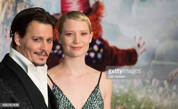 Johnny Depp and Mia Wasikowska attend the European Film Premiere of Alice Through The Looking Glass at Odeon Leicester Square on May 10 2016 in...