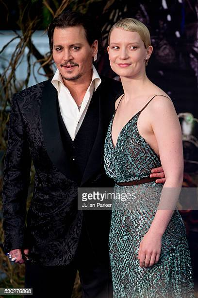 Johnny Depp and Mia Wasikowska attend the European premiere of 'Alice Through The Looking Glass' at Odeon Leicester Square on May 10 2016 in London...