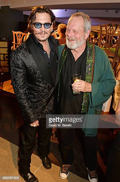 Johnny Depp and Terry Gilliam attend Fortnum Mason's postpremiere party for new release Alice Through the Looking Glass at Fortnum Mason on May 10...