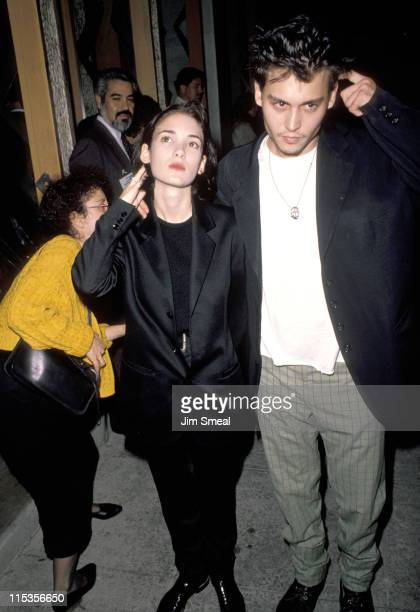 Johnny Depp and Winona Ryder during 'Pacific Heights' Los Angeles Premiere at Avco Westwood Theatre in Los Angeles CA United States