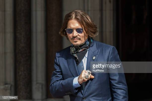 Johnny Depp arrives at the Royal Courts of Justice on day fourteen of the hearing on the libel case against The Sun newspaper on 24 July, 2020 in...