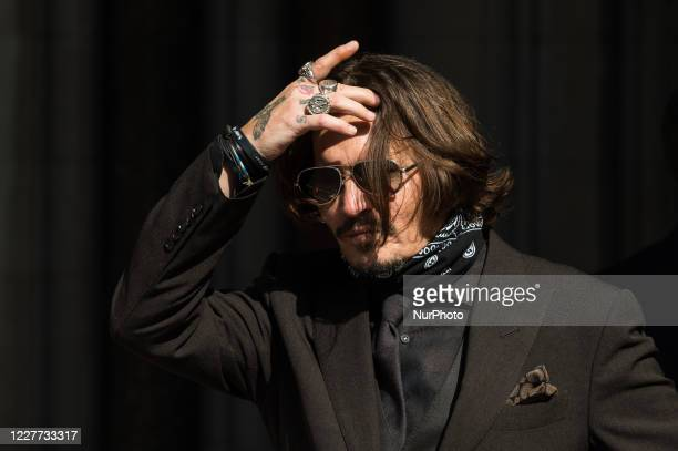 Johnny Depp arrives at the Royal Courts of Justice on day twelve of the hearing on the libel case against The Sun newspaper on 22 July, 2020 in...