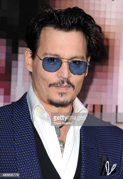 "Johnny Depp arrives at the ""Transcendence"" - Los Angeles Premiere at Regency Village Theatre on April 10, 2014 in Westwood, California."