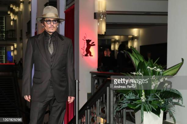Johnny Depp arrives for the Minamata premiere during the 70th Berlinale International Film Festival Berlin at FriedrichstadtPalast on February 21...