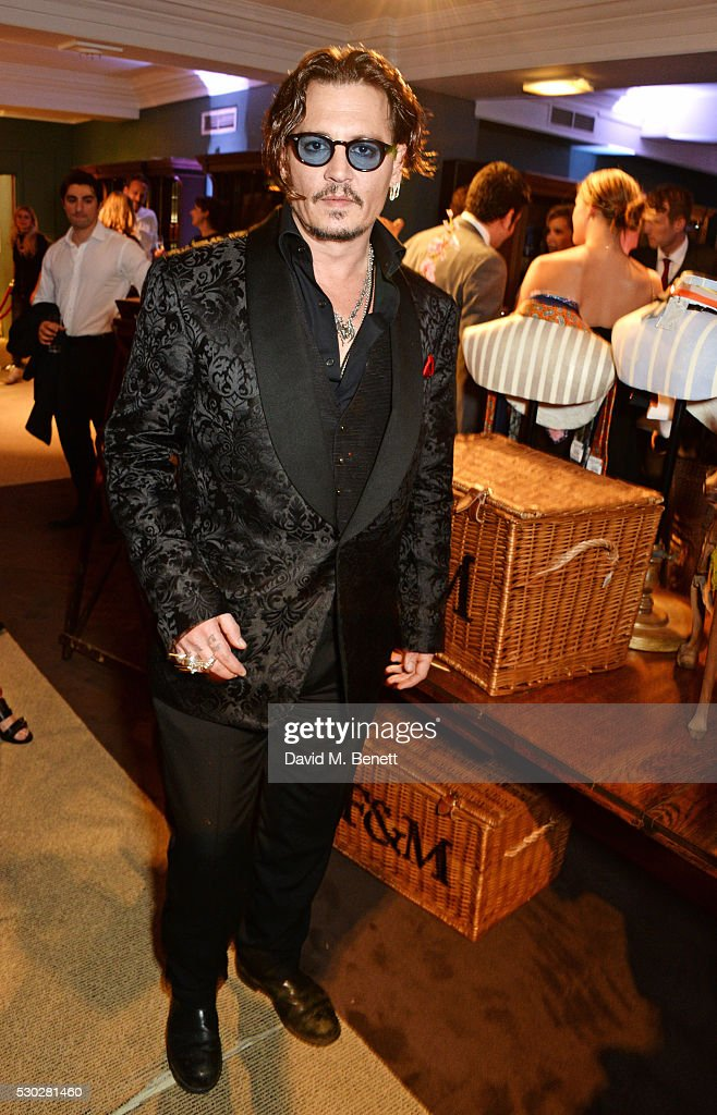 Johnny Depp attends Fortnum & Mason's post-premiere party for new release 'Alice Through the Looking Glass' at Fortnum & Mason on May 10, 2016 in London, England.