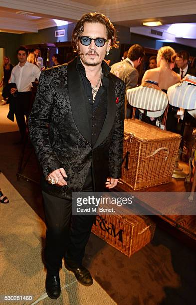 Johnny Depp attends Fortnum Mason's postpremiere party for new release Alice Through the Looking Glass at Fortnum Mason on May 10 2016 in London...