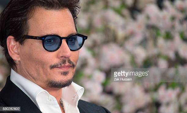 Johnny Depp attends the European Film Premiere of Alice Through The Looking Glass at Odeon Leicester Square on May 10 2016 in London England