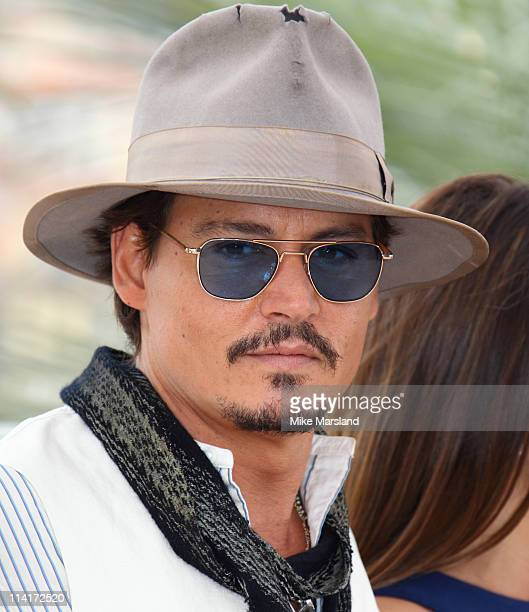 Johnny Depp attends the 'Pirates of the Caribbean On Stranger Tides' photocall at the Palais des Festivals during the 64th Cannes Film Festival on...
