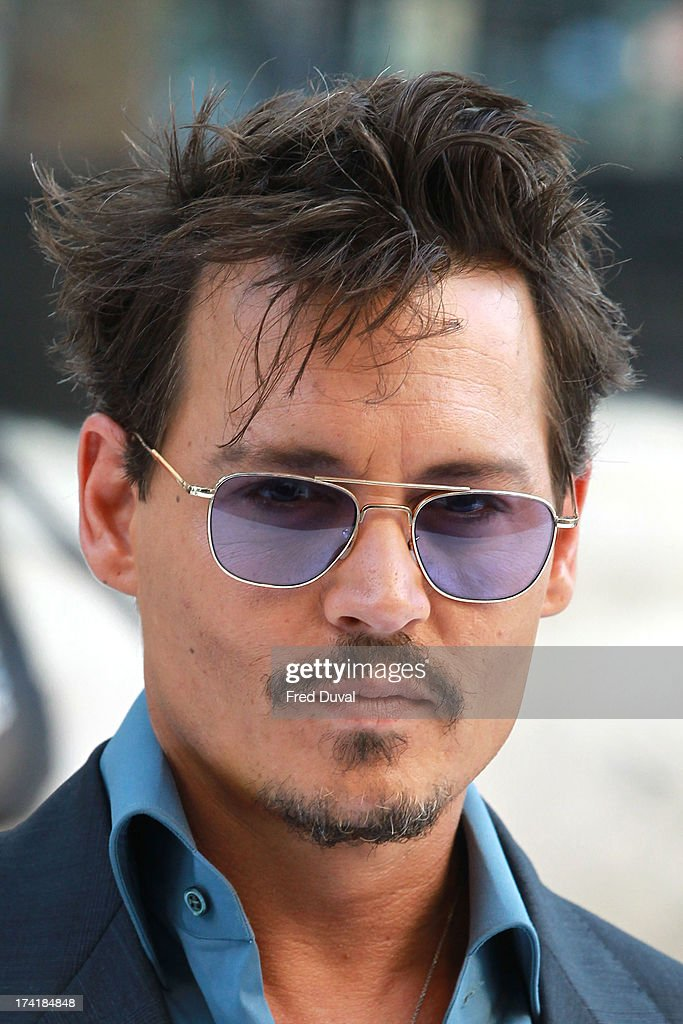 Johnny Depp attends the premiere of 'The Lone Ranger' at Odeon Leicester Square on July 21, 2013 in London, England.