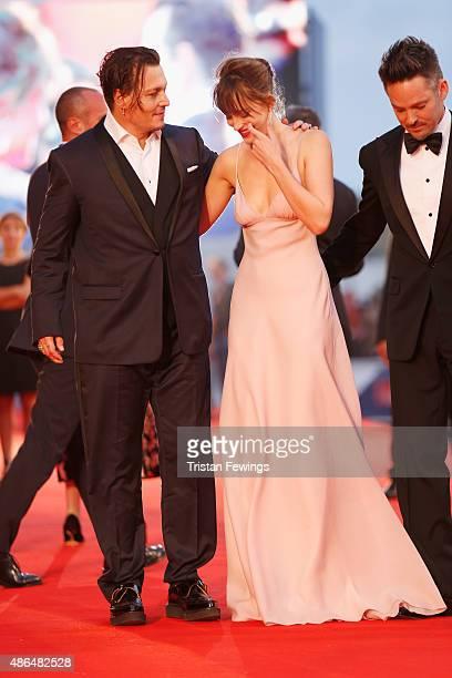 Johnny Depp Dakota Johnson and director Scott Cooper attend a premiere for 'Black Mass' during the 72nd Venice Film Festival at on September 4 2015...