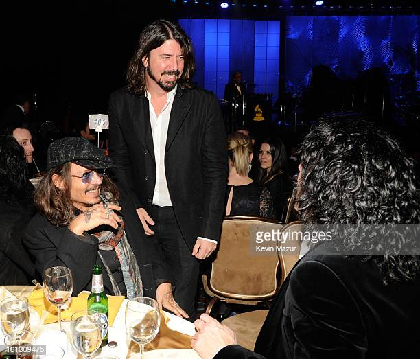 Johnny Depp Dave Grohl and Paul Stanley attend the 55th Annual GRAMMY Awards PreGRAMMY Gala and Salute to Industry Icons honoring LA Reid held at The...