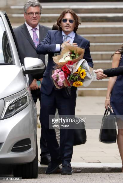 Johnny Depp departs the Royal Courts of Justice, the Strand on July 24, 2020 in London, England. The Hollywood actor is suing News Group Newspapers...