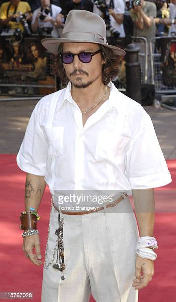 """Johnny Depp during """"Pirates of The Caribbean 2: Dead Man's Chest"""" London Premiere at Odeon Leicester Square in London, Great Britain."""