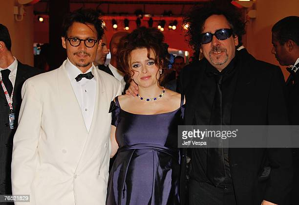 Johnny Depp, Helena Bonham Carter and Tim Burton poses with the Golden Lion For Lifetime Achievement Award after attending the ceremony in Venice...