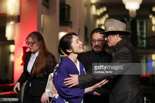 Johnny Depp Hiroyuki Sanada and Akiko Iwase arrive for the Minamata premiere during the 70th Berlinale International Film Festival Berlin at...