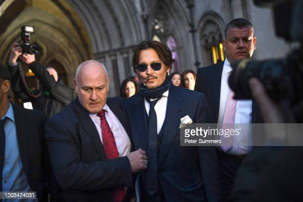 Johnny Depp is seen leaving the Royal Courts of Justice on February 26 2020 in London England The Hollywood actor is suing The Sun newspaper over...