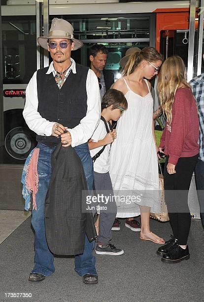 Johnny Depp, Jack Depp, Amber Heard and Lily Rose Melody Depp arrive at Narita International Airport on July 16, 2013 in Narita, Japan.