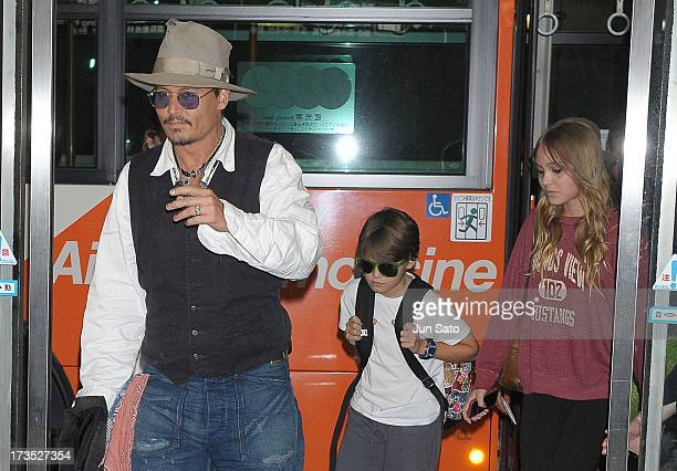 Johnny Depp Jack Depp and Lily Rose Melody Depp arrive at Narita International Airport on July 16 2013 in Narita Japan