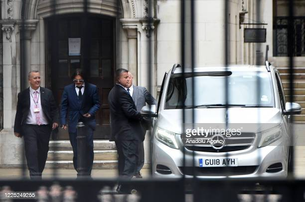 Johnny Depp leaves the Royal Courts of Justice Strand on July 07 2020 in London England The American actor is taking News Group Newspapers publishers...