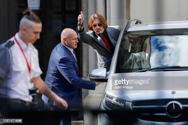 Johnny Depp leaves the Royal Courts of Justice, Strand on July 21, 2020 in London, England. The Hollywood Actor is suing News Group Newspapers and...