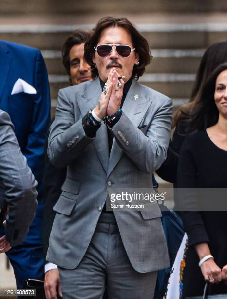 Johnny Depp leaves the Royal Courts of Justice, Strand on July 28, 2020 in London, England. The Hollywood Actor is suing News Group Newspapers and...