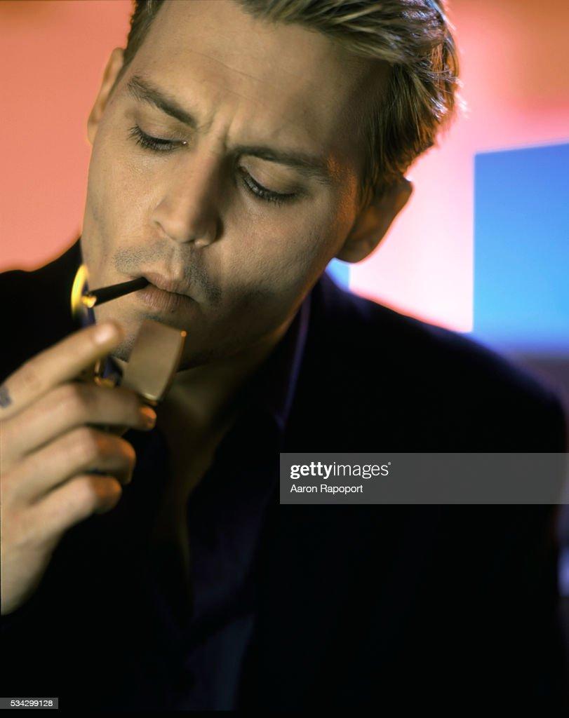 Johnny Depp Lighting A Cigarette