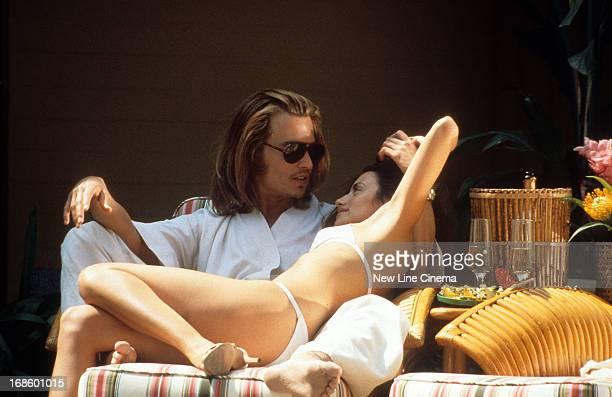 Johnny Depp lounging with Penelope Cruz in a scene from the film 'Blow' 2001