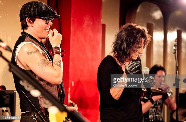Johnny Depp performs on stage with Alice Cooper at an intimate club gig and played guitar on 'Eighteen' and 'School's Out' at The 100 Club on June 26...