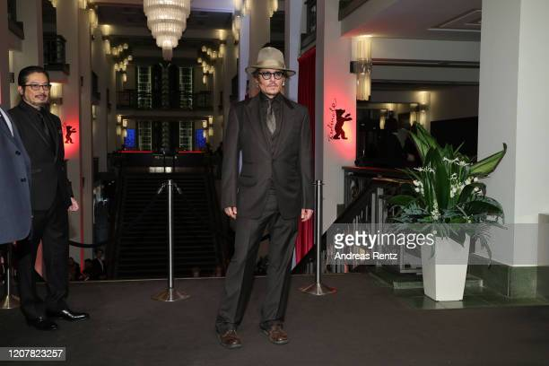 "Johnny Depp poses next to Hiroyuki Sanada at the ""Minamata"" premiere during the 70th Berlinale International Film Festival Berlin at..."