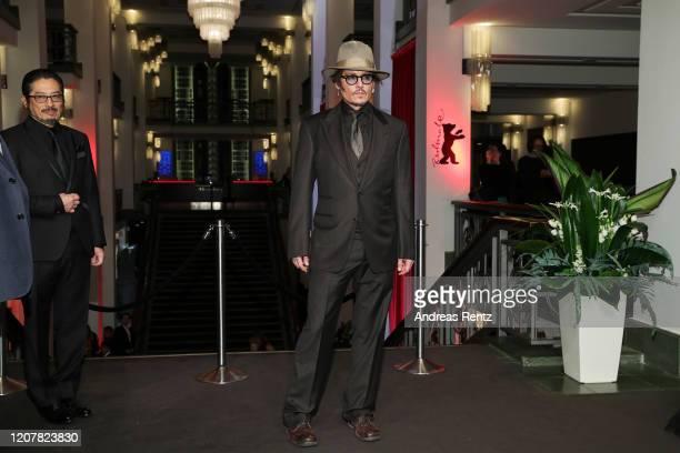 Johnny Depp poses next to Hiroyuki Sanada at the Minamata premiere during the 70th Berlinale International Film Festival Berlin at...