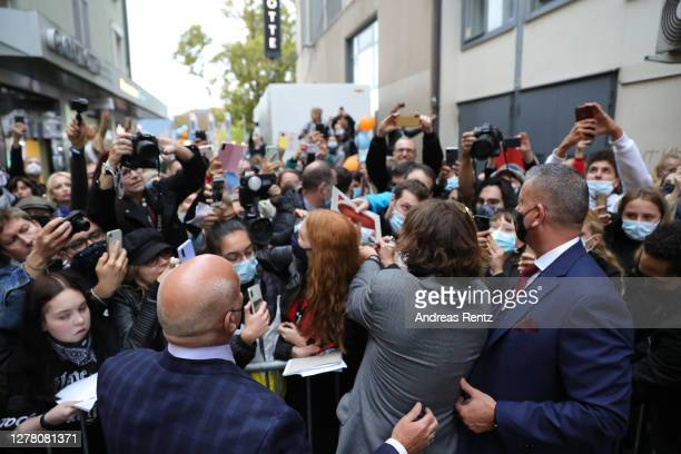Johnny Depp signs autographs upon his arrival for the Crock of Gold A few Rounds with Shane McGowan premiere during the 16th Zurich Film Festival at...