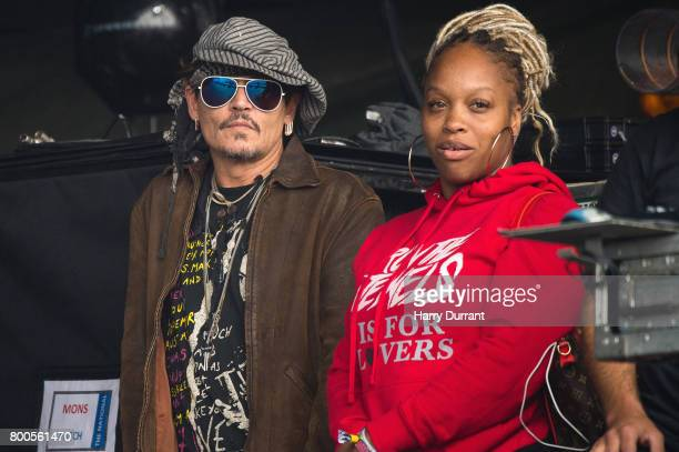Johnny Depp sits at the side of the Pyramid Stage watching 'Run The Jewels' perform on day 3 of the Glastonbury Festival 2017 at Worthy Farm Pilton...