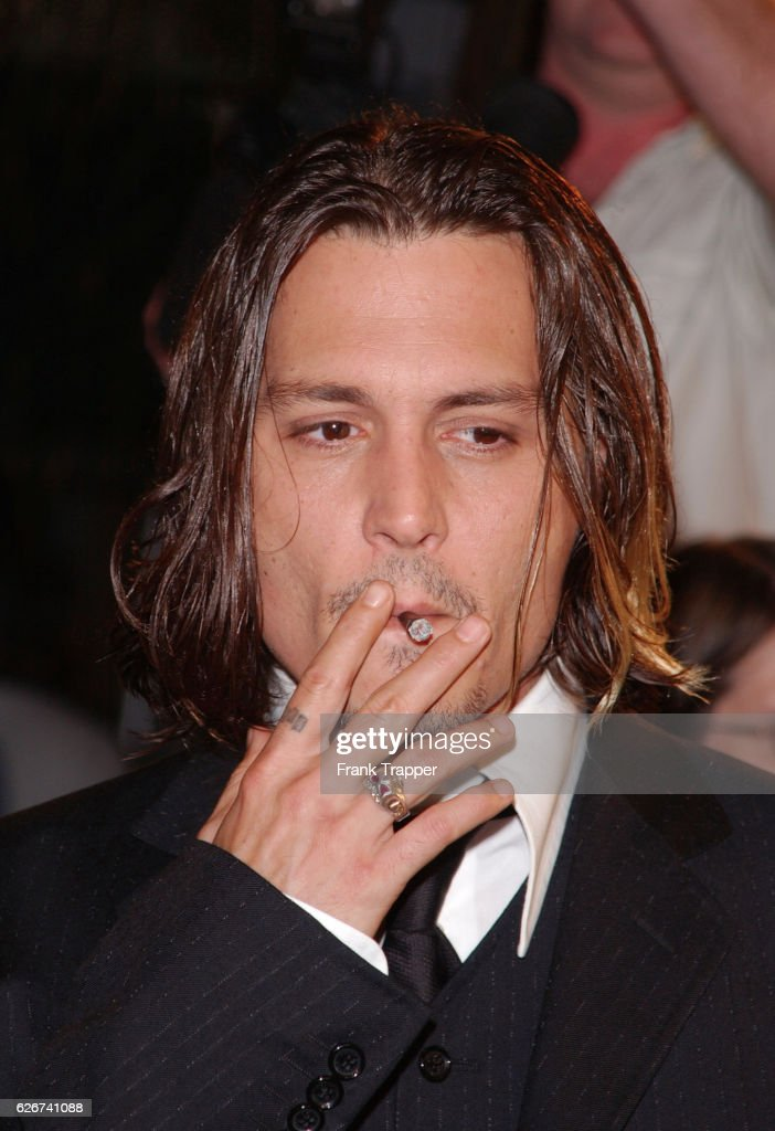 Johnny Depp Co Star Of Film Smokes A Cigarette As He Arrives At