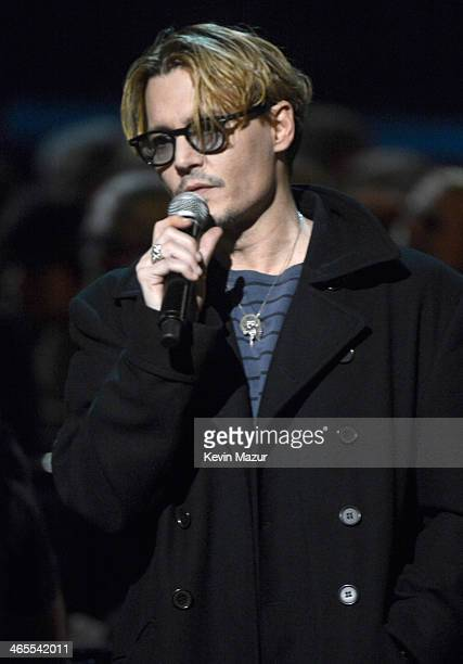 Johnny Depp speaks onstage at The Night That Changed America A GRAMMY Salute To The Beatles at Los Angeles Convention Center on January 27 2014 in...