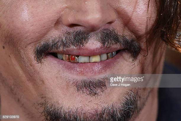 Johnny Depp Teeth Detail Attends A Photocall For Alice Through The Looking Glass At