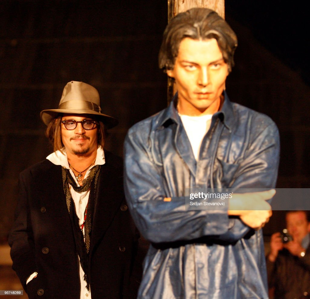 Johnny Depp unveils a statue of Johnny Depp during the Kustendorf film festival on January 13, 2010 in Belgrade, Serbia.