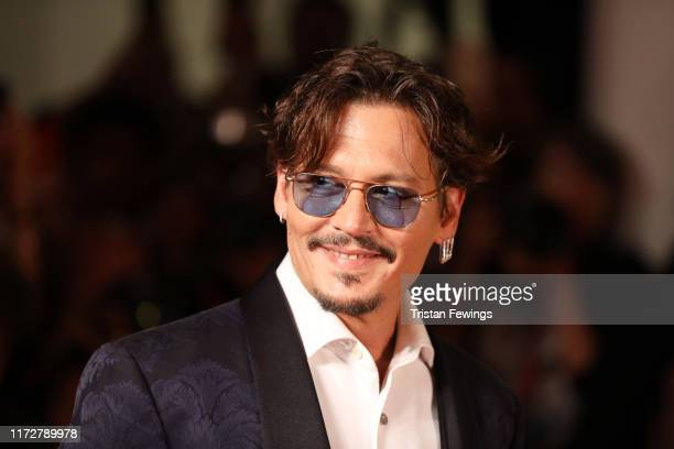"Johnny Depp walks the red carpet ahead of the ""Waiting For The Barbarians"" screening during the 76th Venice Film Festival at Sala Grande on September..."