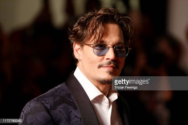 Johnny Depp walks the red carpet ahead of the Waiting For The Barbarians screening during the 76th Venice Film Festival at Sala Grande on September...