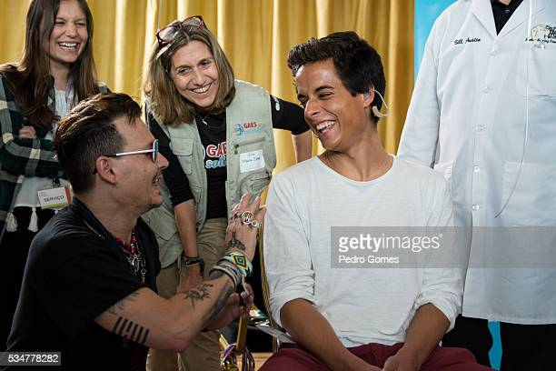 Johnny Depp with a patient of the Starkey Hearing Foundation at Four Season Hotel Ritz Lisbon on May 27 2016 in Lisbon Portugal