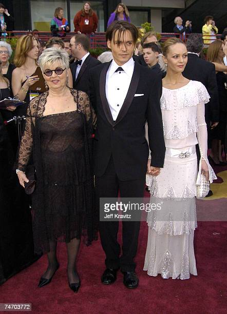 Johnny Depp with his mother and Vanessa Paradis at the The 76th Annual Academy Awards - Arrivals by Jeff Kravitz at Kodak Theatre in Hollywood,...
